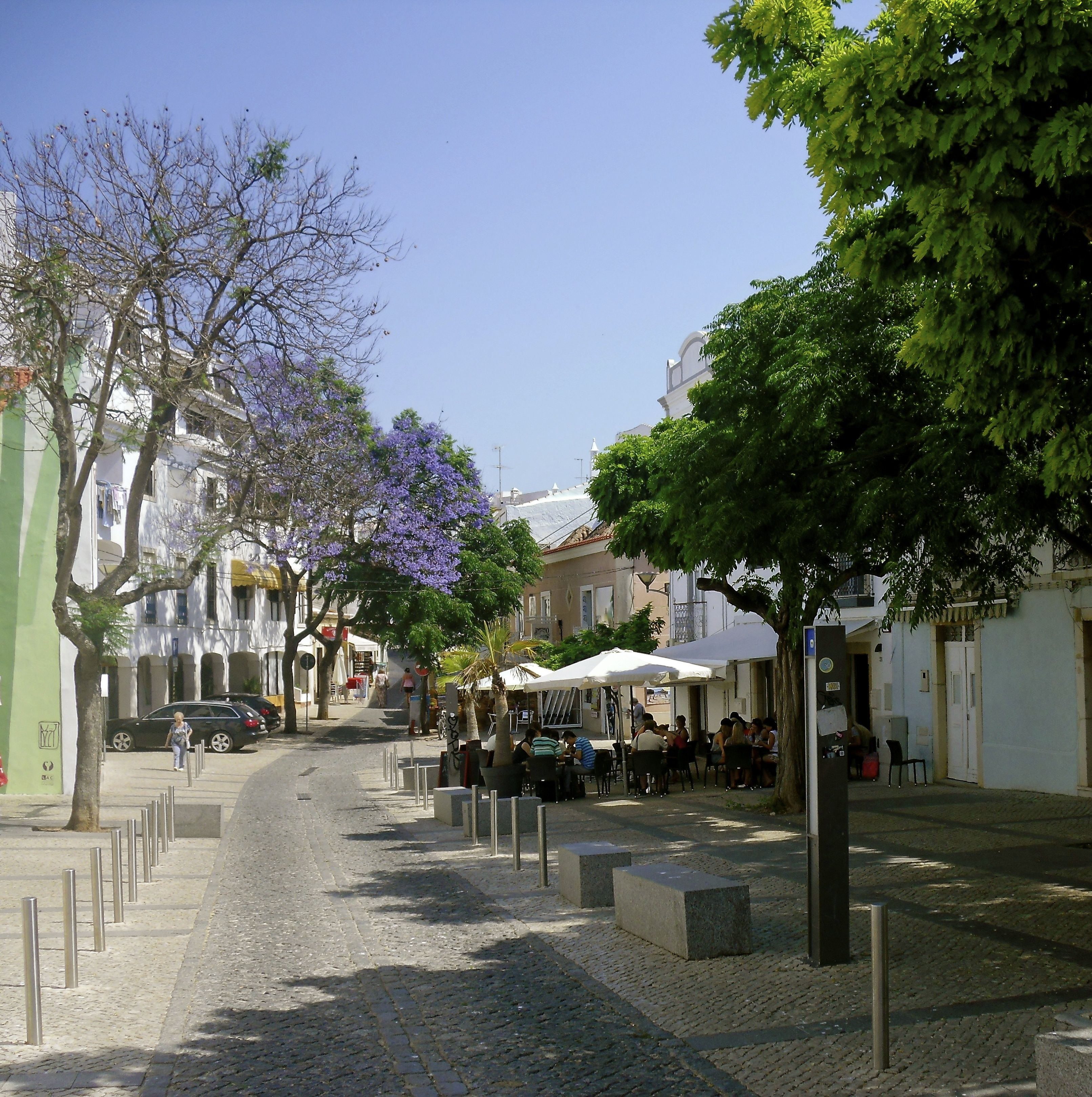 The Cobbled Streets In Lagos Portugal Discover All The Different Street Restaurants Serving Up Wonderful Local Cu Lagos Portugal Amazing Destinations Lagos