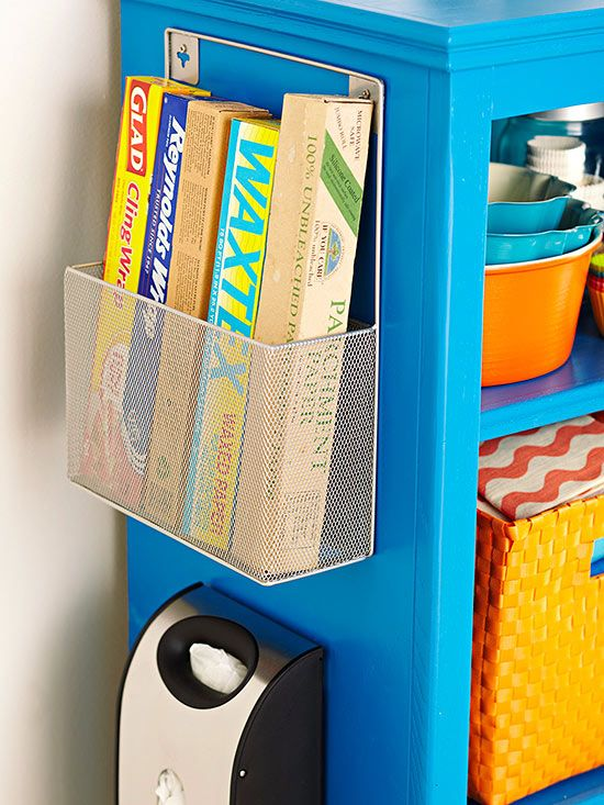 Very often we equate storage with closed doors and drawers, but smaller spaces may necessitate using spots that are in view. Consider grouping same-size items -- here, rolls of essential kitchen papers and wraps -- in a decorative storage piece that accents metals or hues in the room.