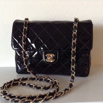 Chanel Patent Mini Flap Black Cross Body Bag. Get the trendiest Cross Body  Bag of the season! The Chanel Patent Mini Flap Black Cross Body Bag is a  top 10 ... dfaf2fdb6e3b4