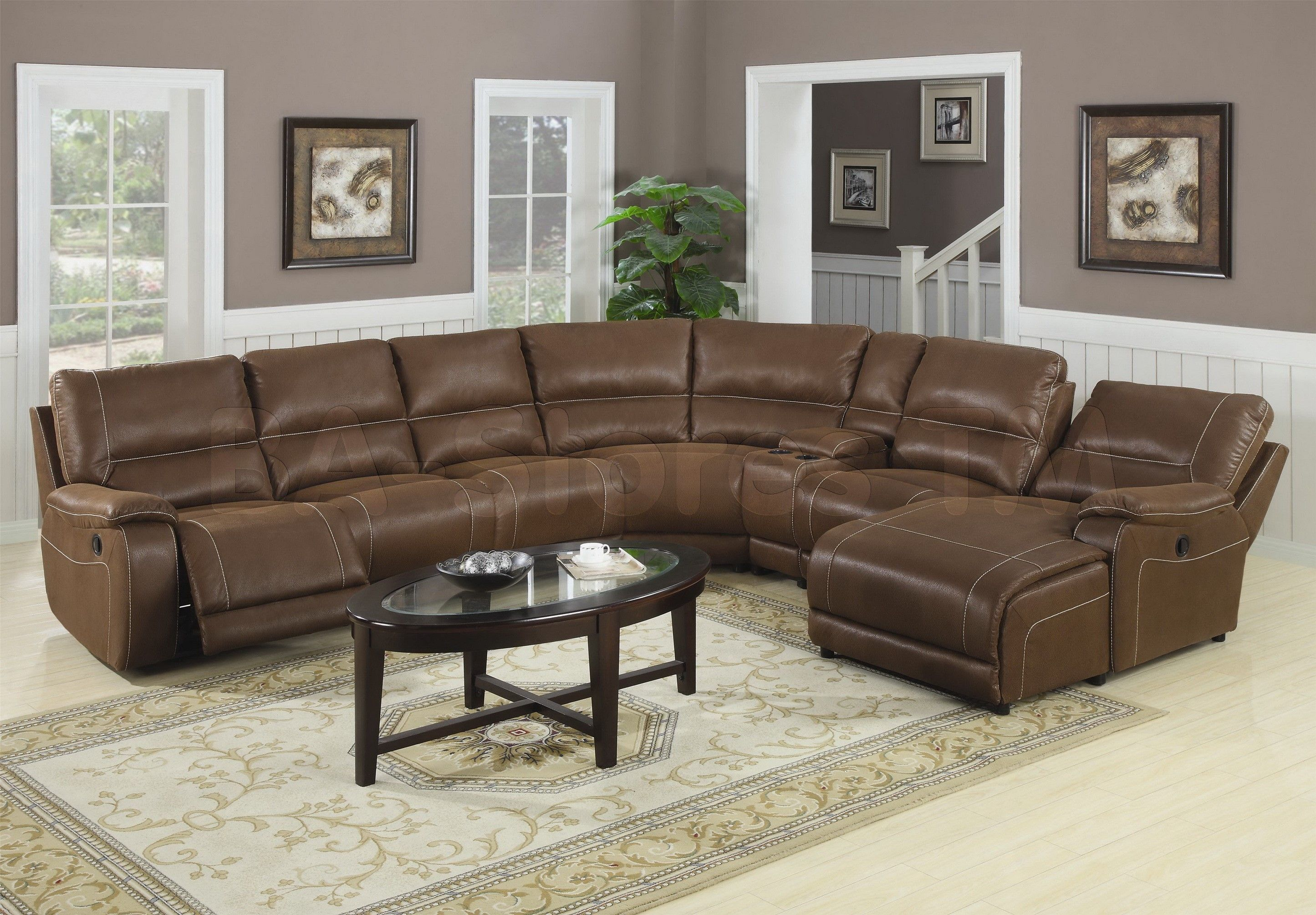 Brown Leather Couch   Place A Small Piece Of Leather On The Opposite Side  Of The Room. An Ottoman In A Similar Tone Combined With Leather Couch And  Give Th