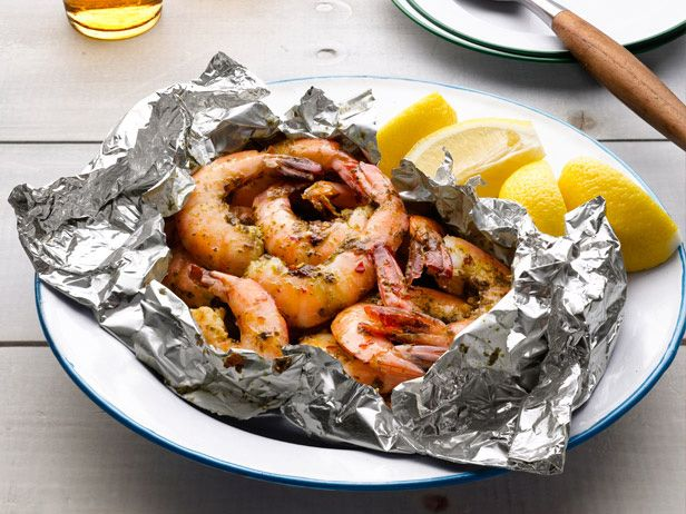 Grilled Garlic Shrimp in Foil    Mix 1/2 stick softened butter, 1 cup chopped parsley, 2 chopped garlic cloves, and salt and pepper. Toss with the juice of 1 lemon, 1 pound unpeeled large shrimp and a big pinch of red pepper flakes. Divide between 2 foil packets. Grill over high heat, 8 minutes.