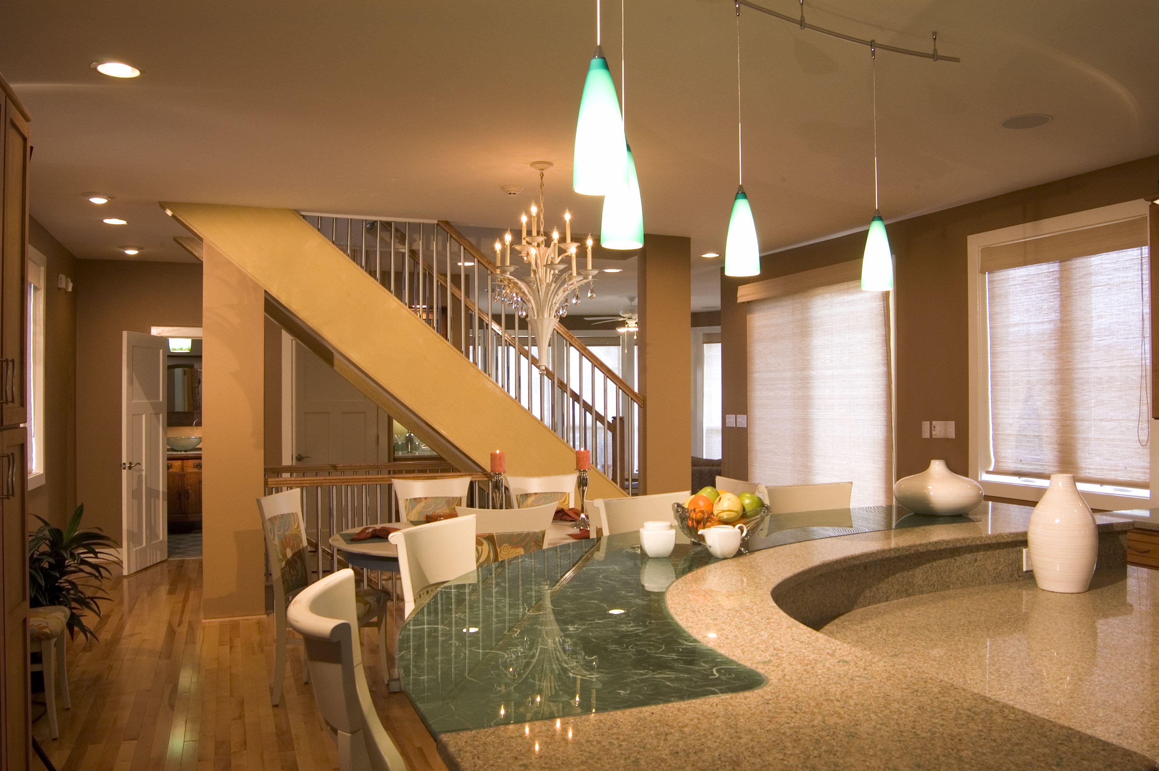 Modern interior.  Custom glass and quartz counter top, stairway, and powder bath vanity. by JRML