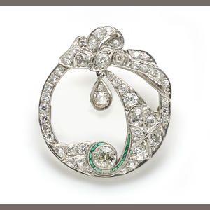 An art deco diamond and synthetic emerald brooch, circa 1920