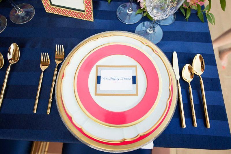 Beautiful navy and pink place setting. Photo by Ely Fair Photography. www.wedsociety.com #wedding #placesetting