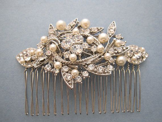 Vintage Inspired Pearls wedding hair comb, wedding hair accessory, pearl bridal comb, wedding hair piece, bridal hair comb, crystal wedding comb  This beautiful, simple and delicate hair comb is made with a clear rhinestone and Swarovski ivory pearl. Perfect for a special occasion or to a add something lovely to your party attire. The brooch is measured approx 3.5 x 1.75 and the comb is approx 3 wide.  ------------------------------------------------------------- New style with hair chain…