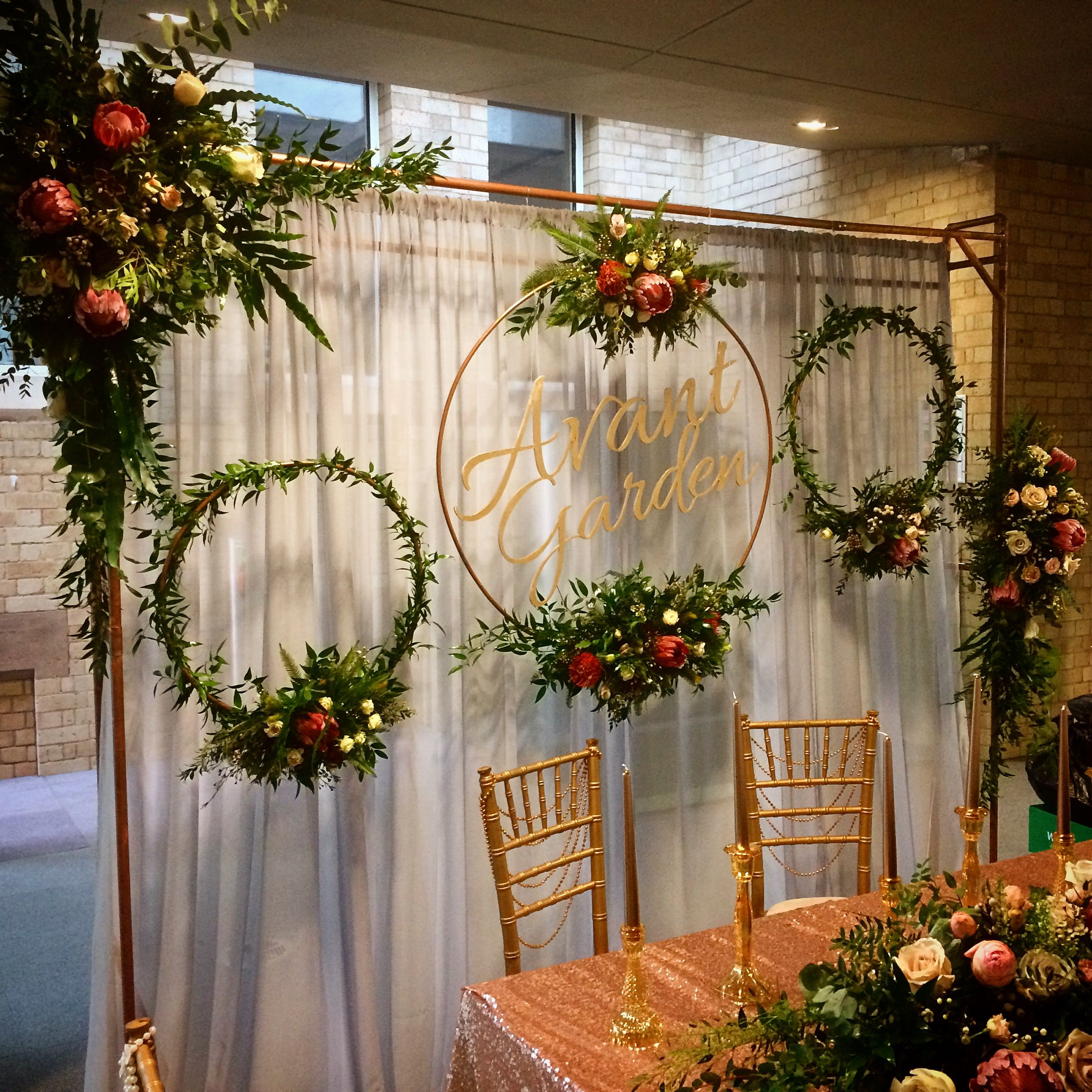 Garden wedding stage decoration  Hmm  Put another curtain rod in front of the sliding door curtains