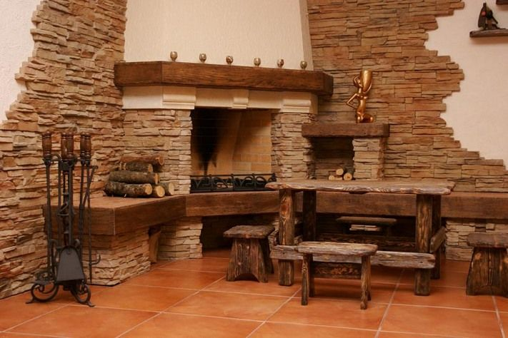 Big village style stacked stone corner fireplace dining for Corner stone fireplace