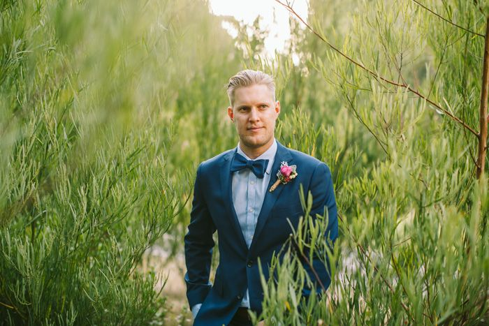 Groom in blue suit | I Take You #groom #bowtie
