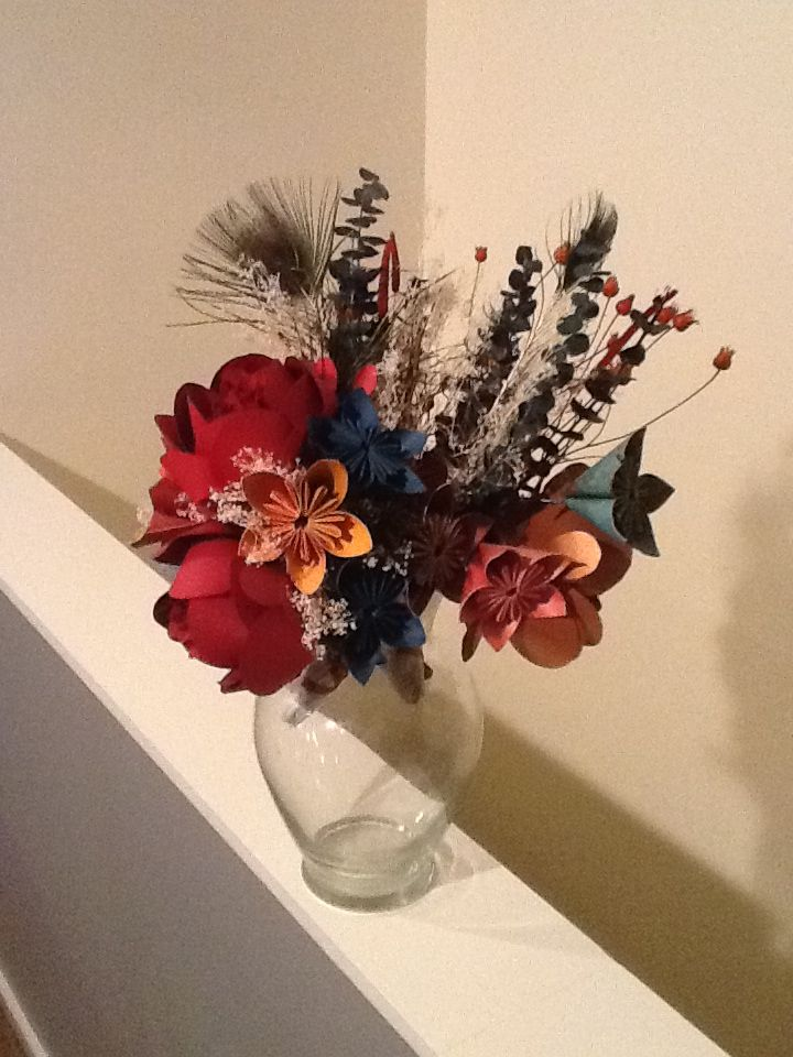 My homemade flowers from our wedding. 15 months later, and they're still goin strong!! Best money-saver/memory maker EVER!!!