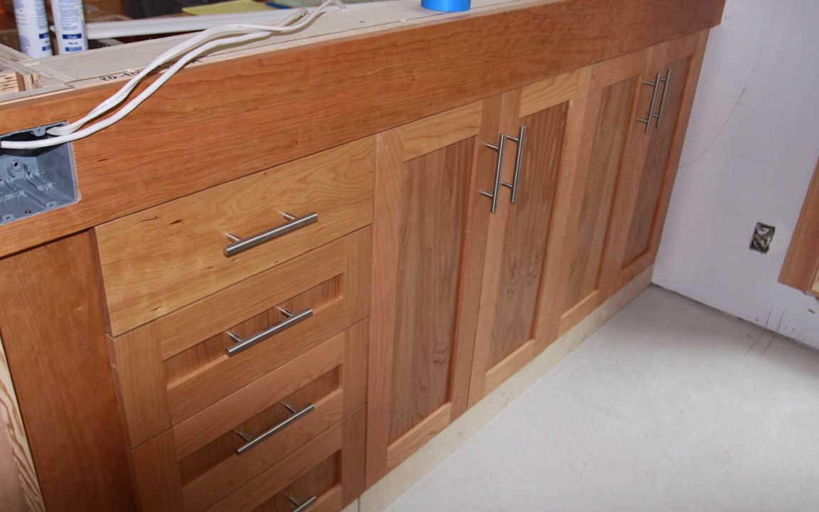 Cherry Shaker cabinets with stainless bar pulls.   Remodel Lower ...