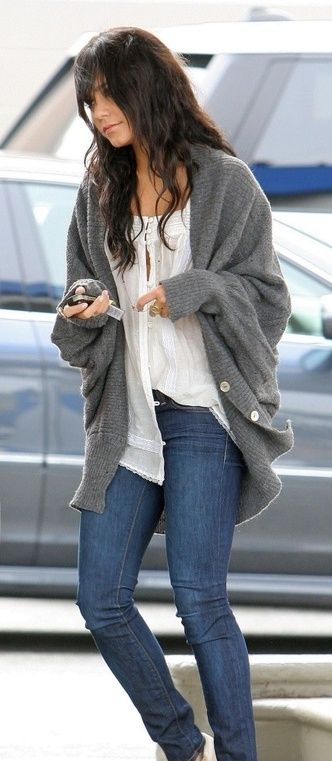 Grey knitted cardigan. White top. Blue Jeans.