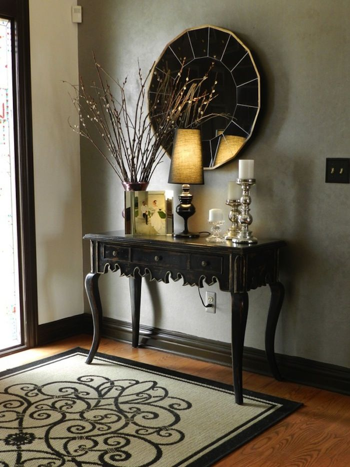 a round glam mirror is an interesting contrast to the slightly distressed finishu2026