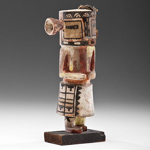 Malo kachina tihu, Hopi. Colton 130 (table 13). [jcx]. Circa 1900. Case mask, tube mouth, rectangular eyes, nose a vertical line : a checker board for Malo. Blossom in place of one ear, tuft of hair on other, with feathers.
