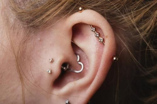 I like the Industrial bar, anyway, but, I think these piercings are feminine and very pretty :)