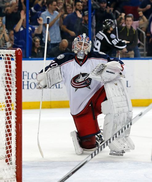 Columbus Blue Jackets goalie Joonas Korpisalo, of Finland, reacts after giving up a goal to Tampa Bay Lightning's Nikita Nesterov, or Russia, during the second period of an NHL hockey game Saturday, Dec. 26, 2015, in Tampa, Fla. The Lightning won 5-2. (AP Photo/Mike Carlson)