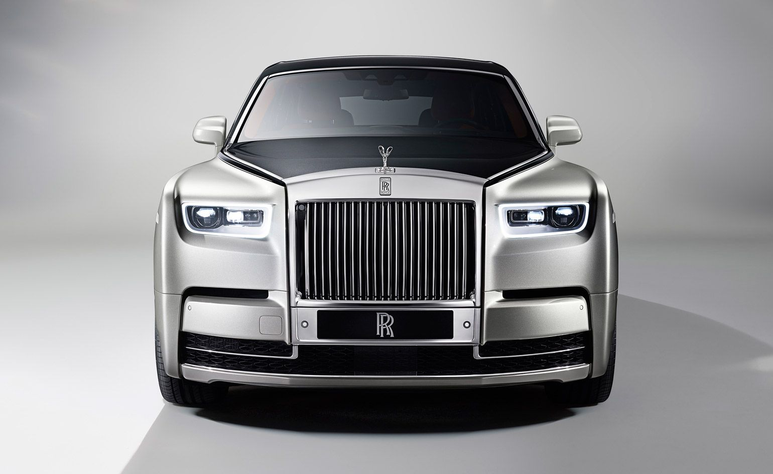 The New Phantom Is A Triumphant Expression Of Rolls Royce S Titanic Ambition Rolls Royce Phantom New Rolls Royce Rolls Royce Wallpaper