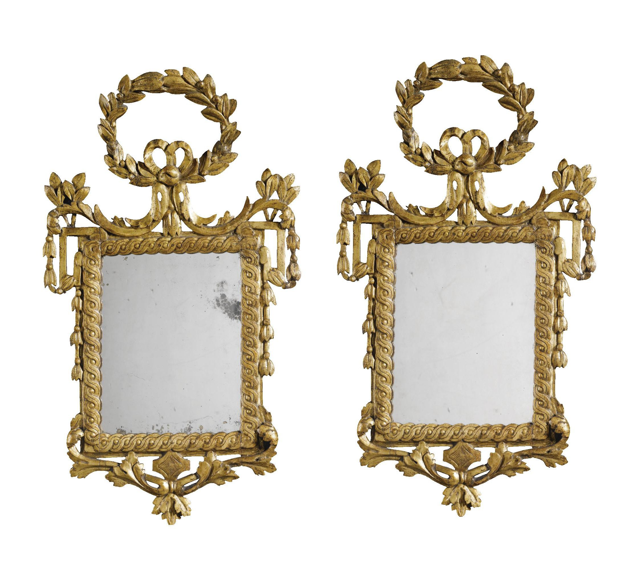 A pair of Italian giltwood wall mirrors, circa 1785, the laurel garland crestings above rectangular plates within guilloche-carved frames flanked by protruding pierced scroll corners - Dim: 80cm. high, 47cm. wide; 2ft. 7½ in., 1ft. 6½ in.