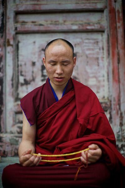 "Chinese monk holding mala in buddhist temple"" Wutai Shan, Shanxi, China"