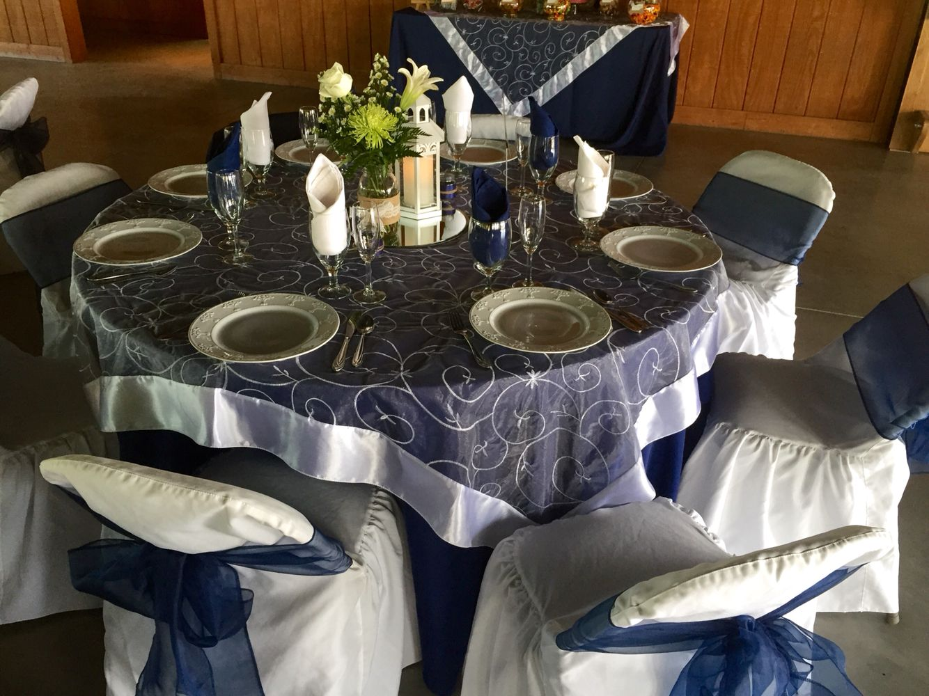 Navy Blue Table Cloth With White Organza Swirl Overlay