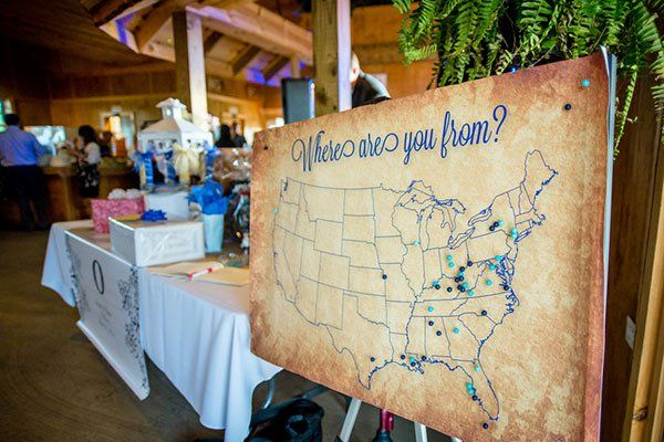 """Have your relatives and friends sign in using a non-traditional """"guest book,"""" like this pinboard map highlighting where guests call home."""