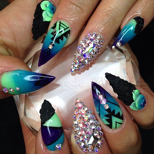 How beautiful are these cassienailz is a must follow one of my blue green black aztec stiletto nails with flowers and ab stones solutioingenieria Gallery