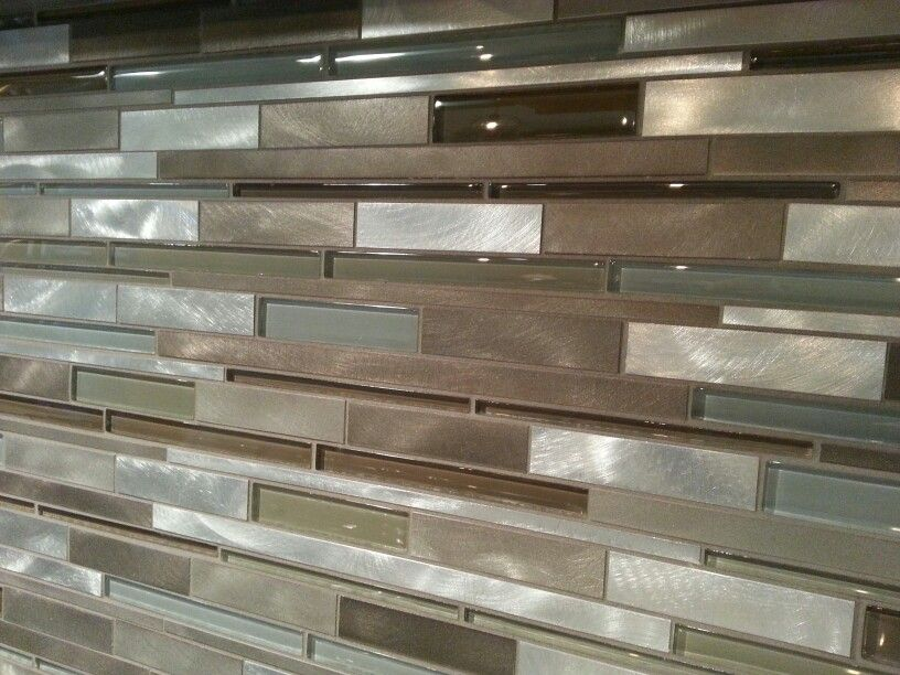 Our kitchen tile backsplash is a mixed glass and metal tile backsplash.  Available at Lowes
