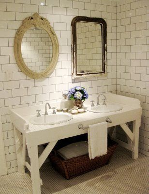 subway tile w/ grey grout; mismatched mirrors; vanity that doesn't make me hurl