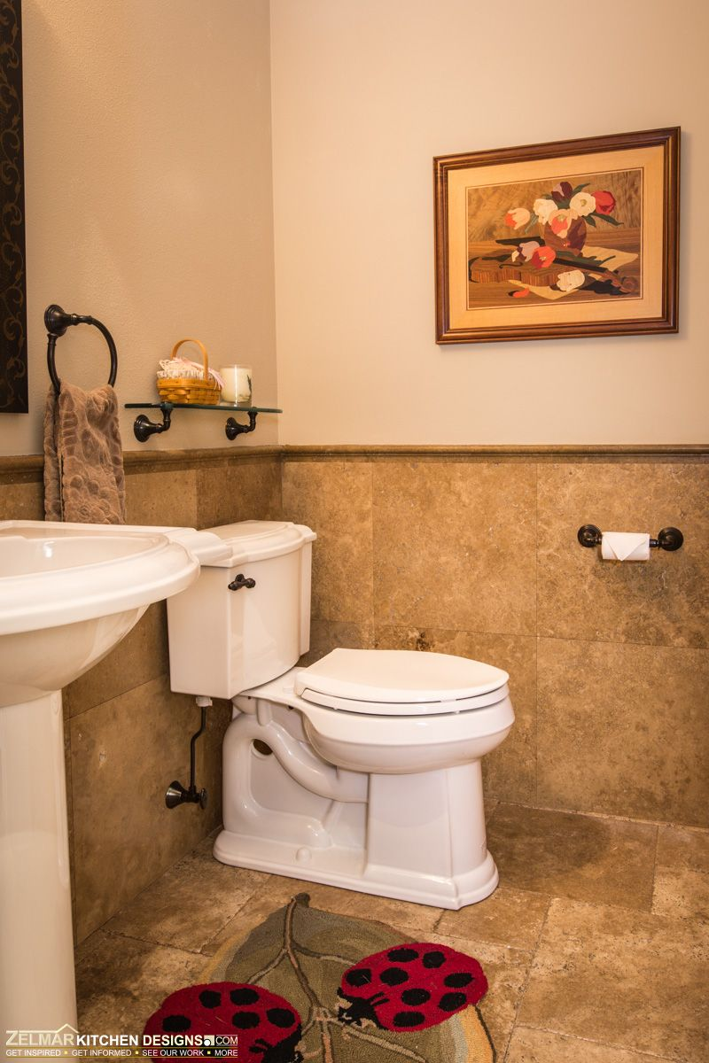 This small bathroom stands out with travertine tiled flooring and ...