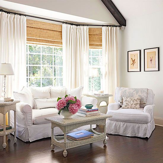 Whitewashed Wicker Tables Along With Linen Slipcovered