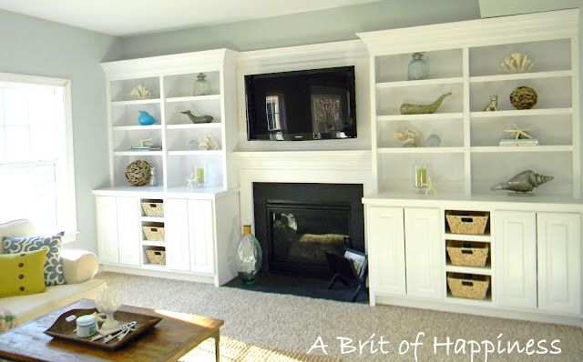 built in shelves around fire place