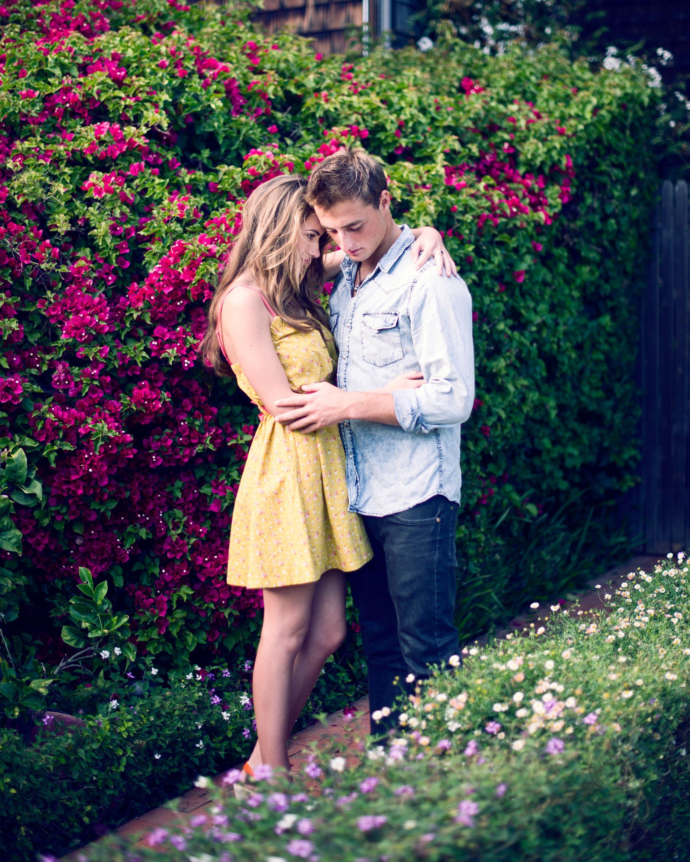 Couple Cuddling In The Flower Garden Cuddling Couples Flower Garden Amazing Gardens