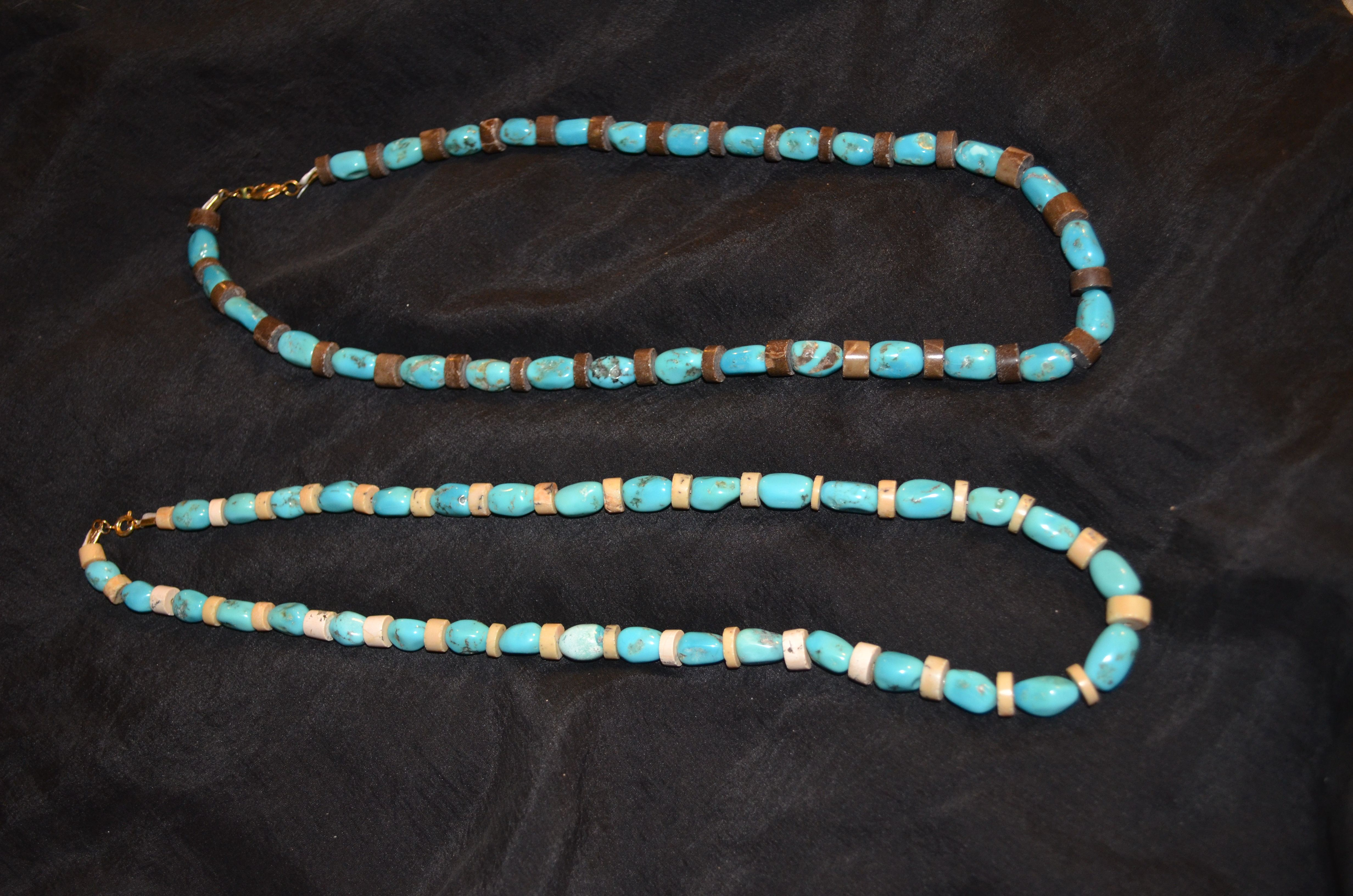 Turquoise necklaces with carved beads separating the stones. I made this.
