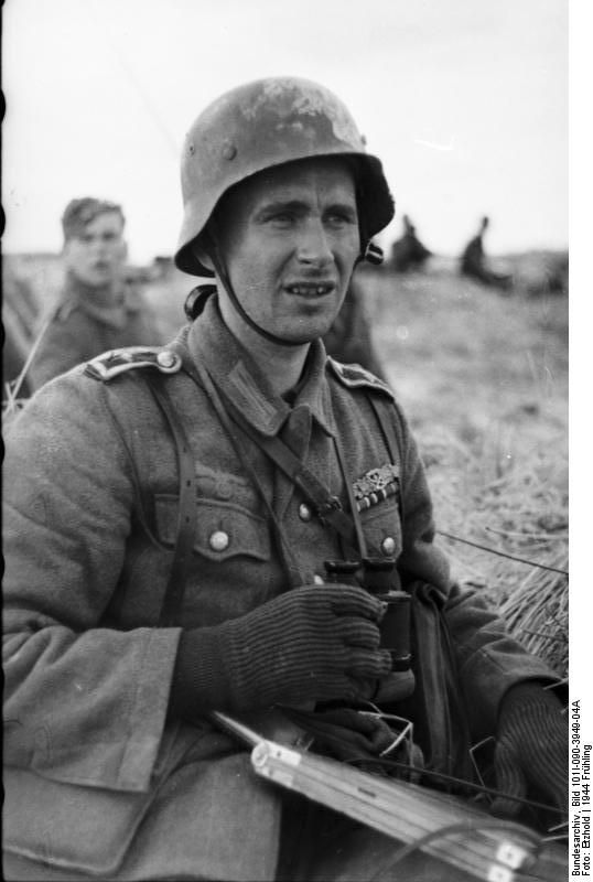 German NCO with field glasses and wearing the much coveted