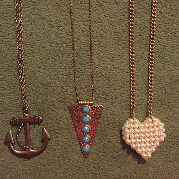 """Long necklace bundle 3 gold necklaces. Not real gold.  Heart made of faux pearls is 16"""" long. Triangle with turquoise circles is 18"""" long. Anchor is 17.5"""" long. Measurements taken from bottom of design to the top of the chain. Triangle one is starting to tarnish. Other ones are perfect. Jewelry Necklaces"""