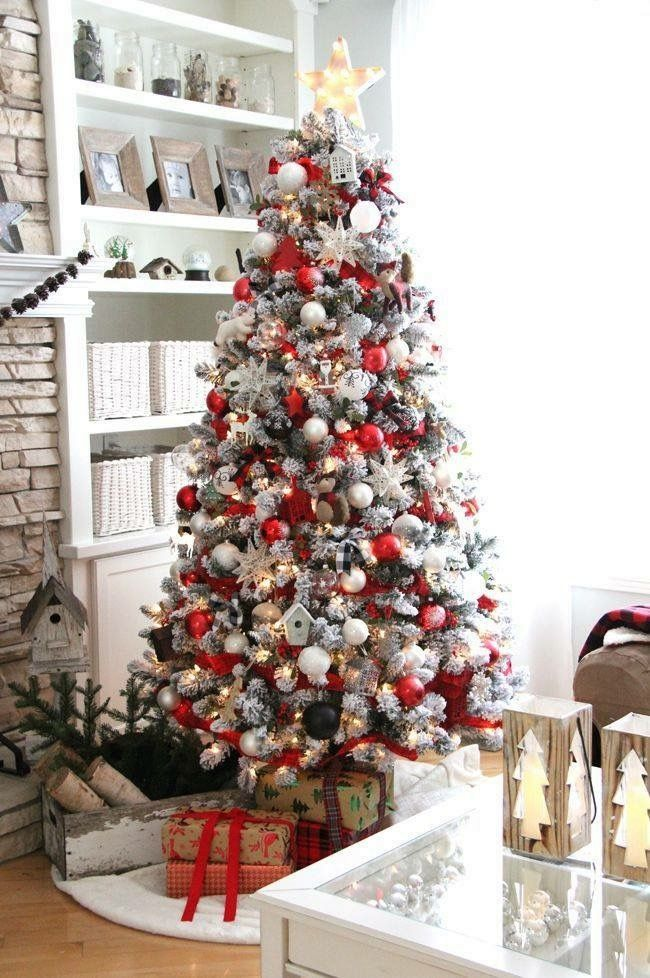 pretty red and white christmas tree with bird houses