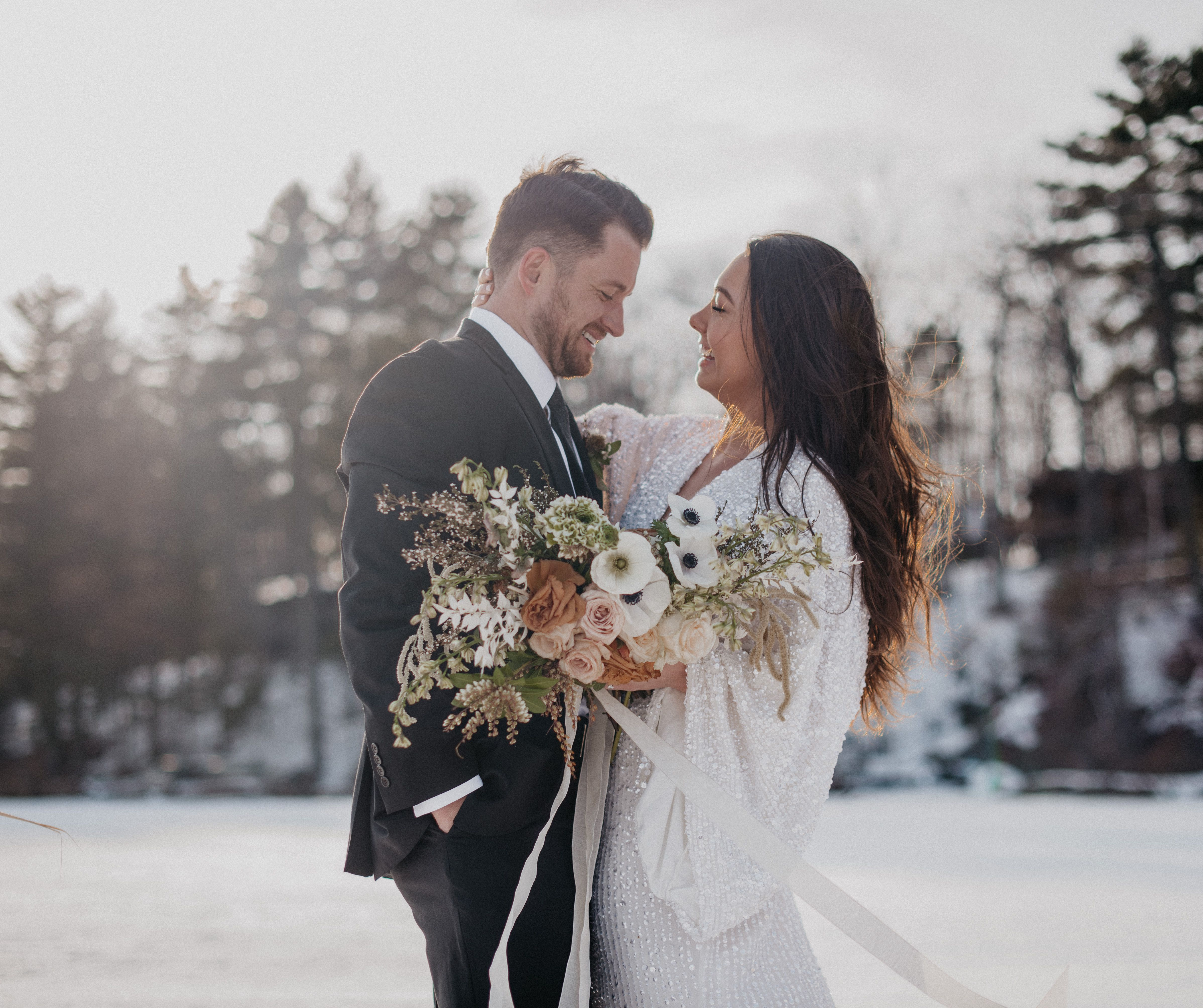 Photo of Frozen Lake Winter Elopement Photos Wedding Floral Inspiration Winter Wedding Outfit Inspiration