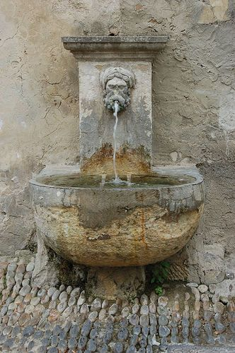 Fountain with stone paving