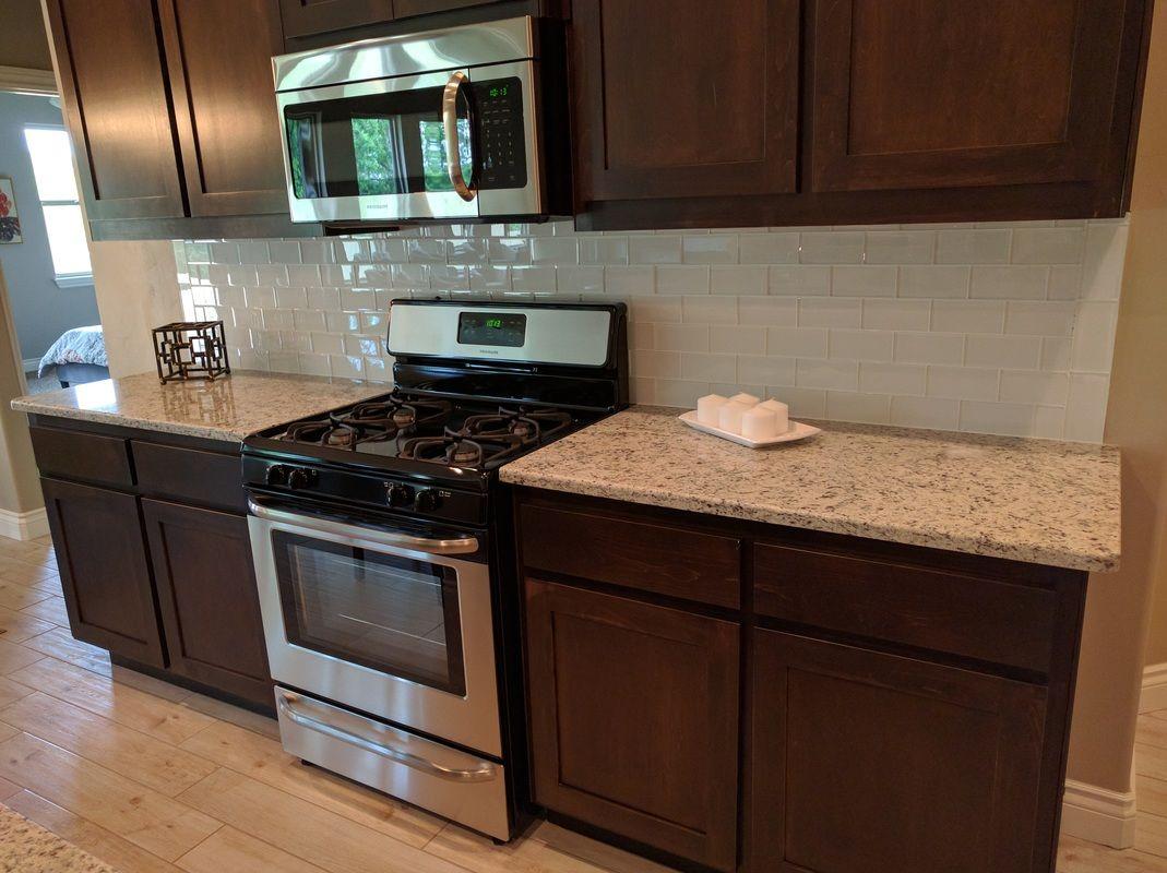 Stunning Kitchen And Bathroom With Dallas White Granite