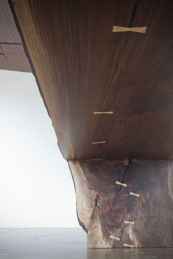 Walnut Waterfall Table, Bronze Trestle Base | Michael Wong | Archinect