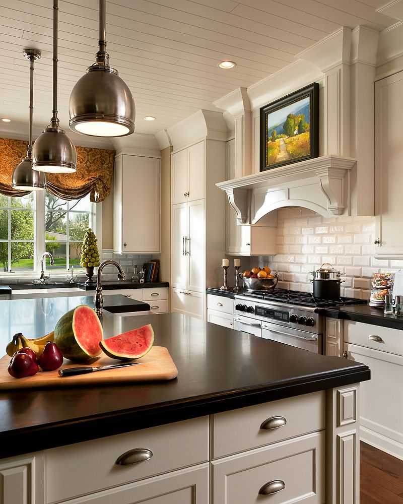 Love beadboard ceiling, dark counters,  white cabinets, and the window.  Have to have a good window in a kitchen  .Love kitchens that look like they belong in a great Victorian.