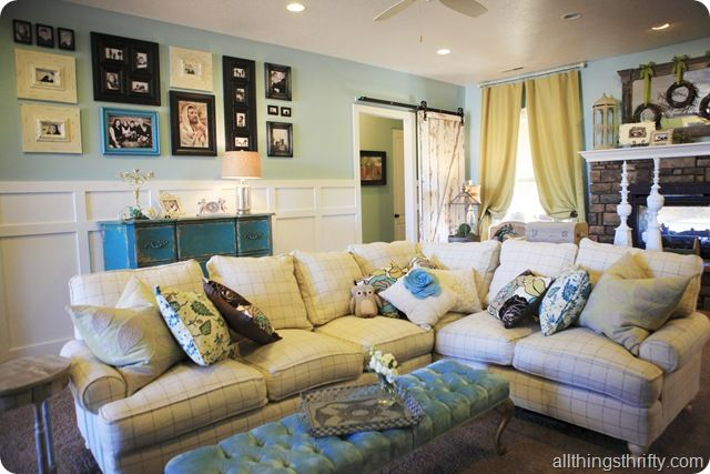 I absolutely LOVE the feel of this room. And the sectional is freaking awesome!