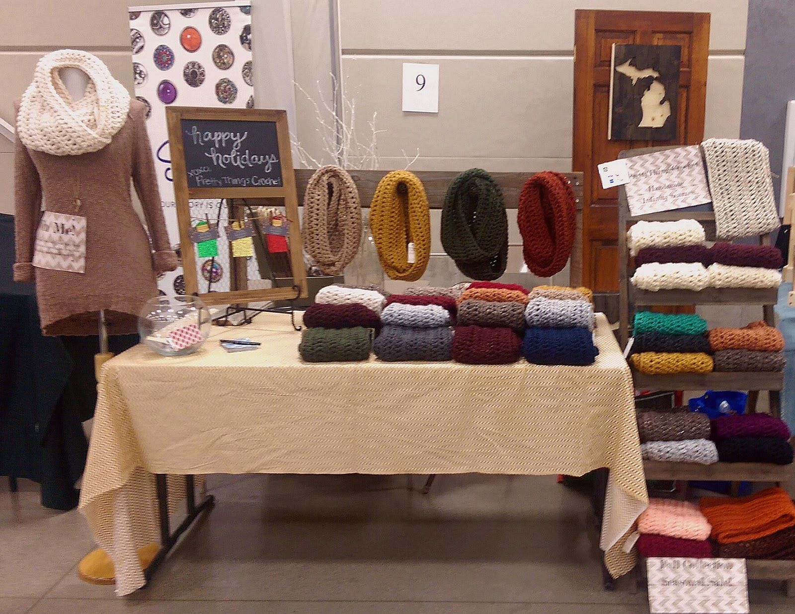 craft show setup and display idea for infinity scarves and crochet goods