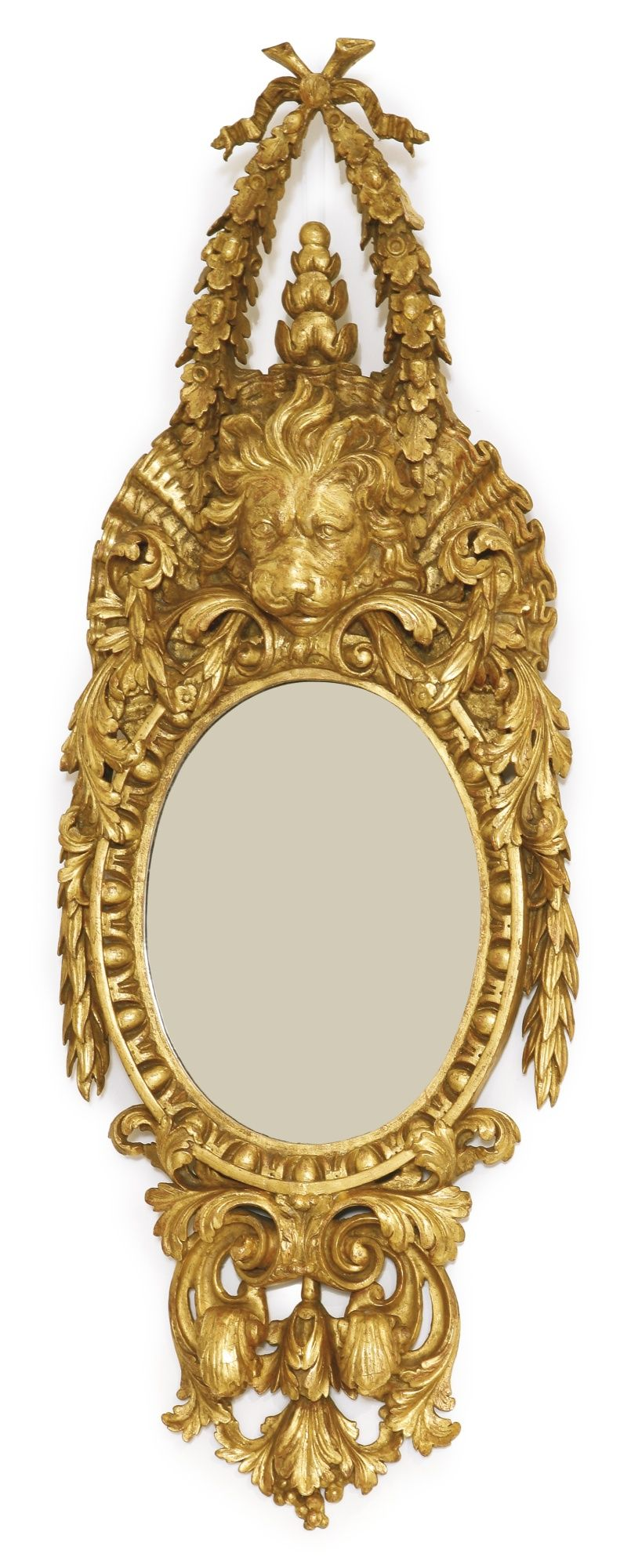 A George II giltwood oval pier mirror in the manner of William Kent ...