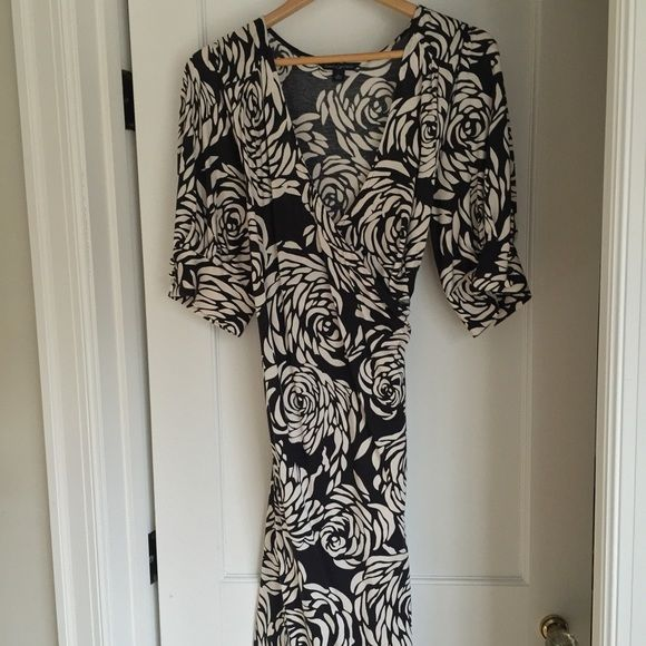 BR mosaic rose print silk-blend wrap dress Silk/cotton blend knit faux wrap dress with self-belt. Hits around the knee area. Worn once to an afternoon wedding. Banana Republic Dresses