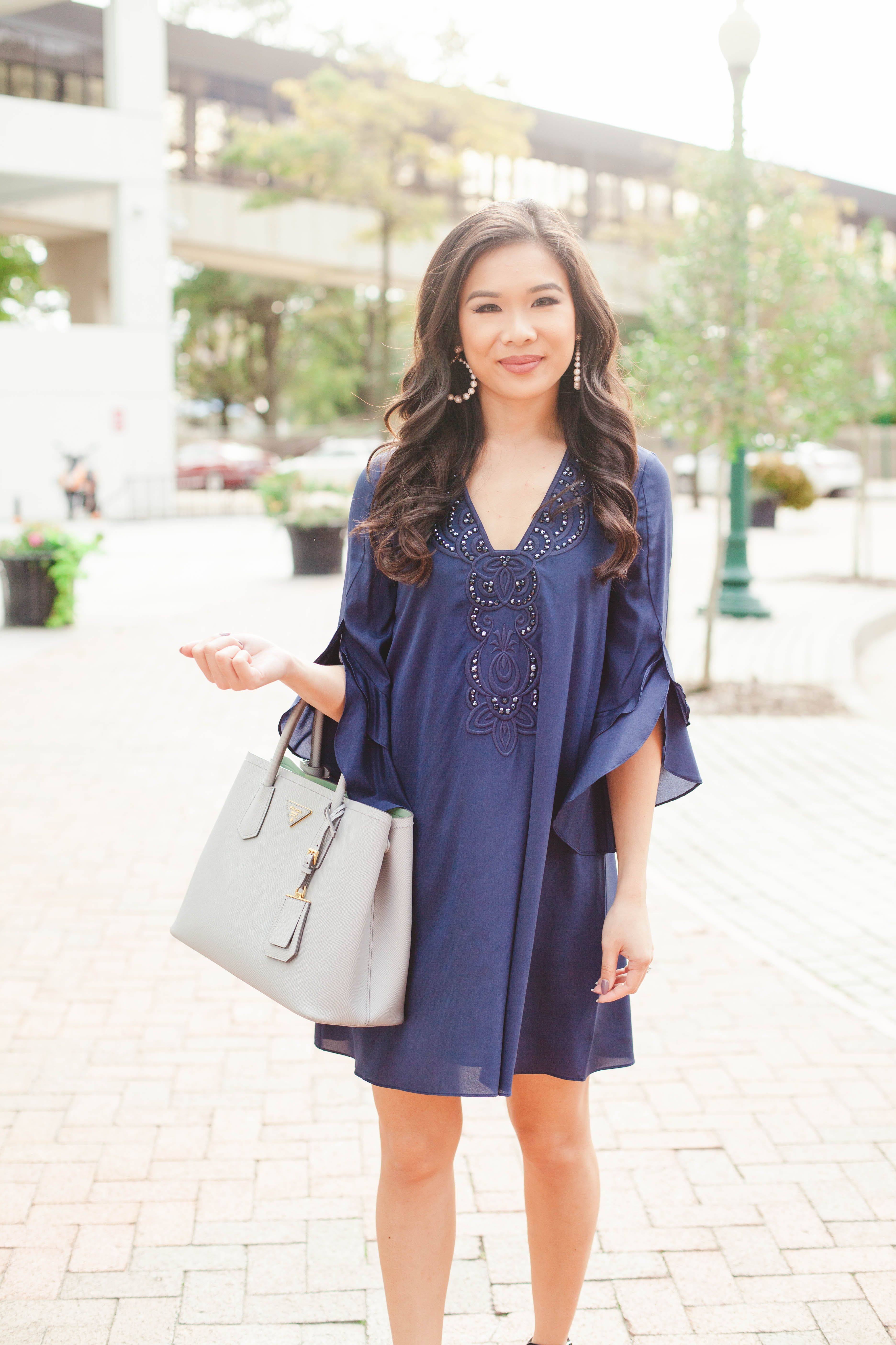 6cc4ab1043223 Navy blue silk tunic dress with layered sleeves and Prada Cuir tote ...