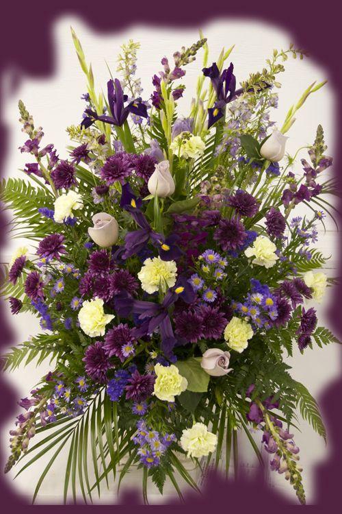 Purple funeral standing spray www.broadwayflorist.com