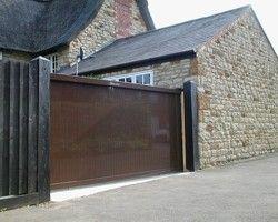 Aluminium Sliding Gate In The Uk Sliding Gate Concrete House Steel Doors