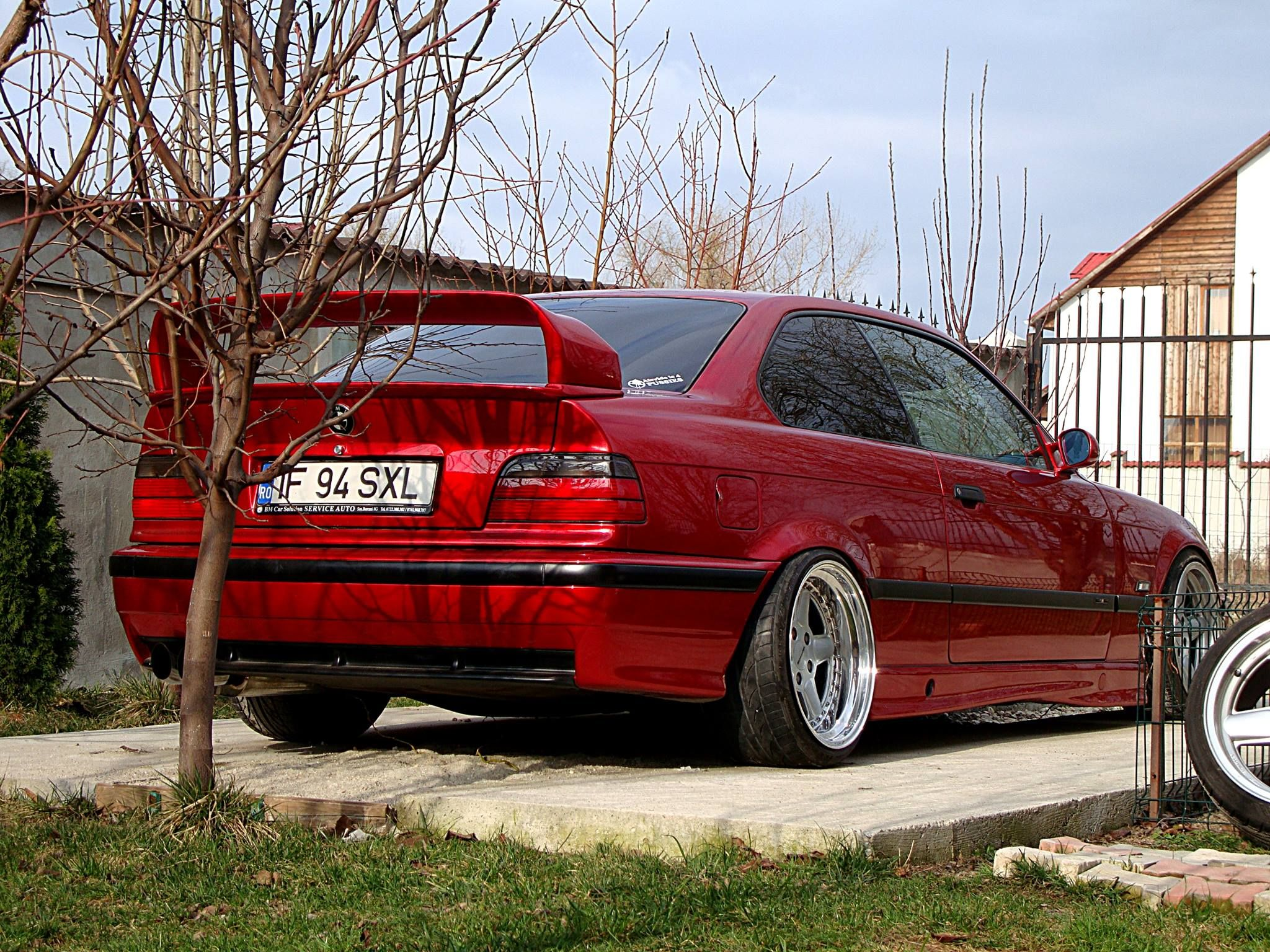 Candy red bmw e36 coup on cult classic oz ac schnitzer type 1 wheels