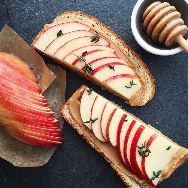 """Peanut butter, apple, honey, and thyme on bread. Such a nice idea and picture by @breadbunnie."