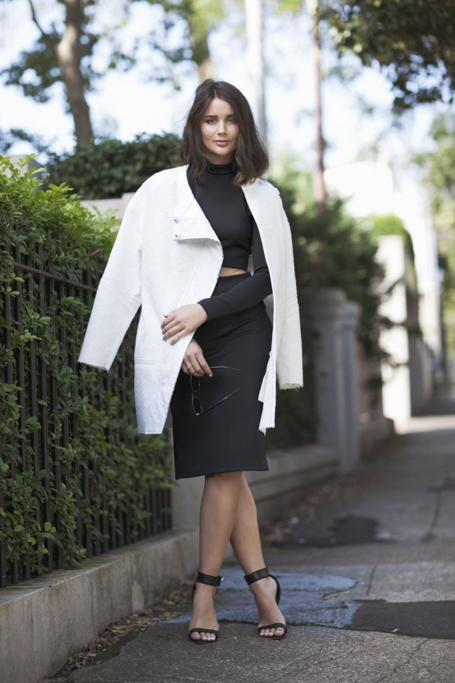 white coat in black outfit